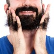 combing-through-the-beard-with-wet-fingers